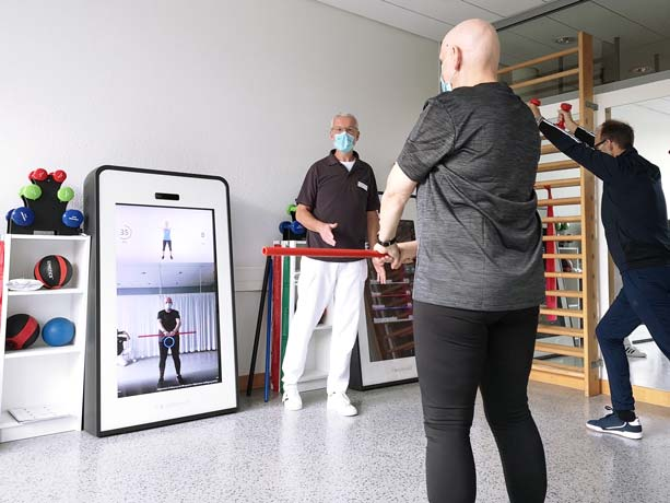 Patients during supervised training with the Pixformance Station 1.0